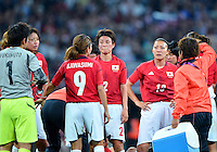 August 09, 2012: Japan's Yukari Kinga, Karina Maruyama, Nahomi Kawasumi weep at the conclusion of Women's Football Final match at the Wembley Stadium on day thirteen in Wembley, England. USA defeat Japan 2-1 to win it's third consecutive Olympic gold medal in women's soccer. ..