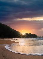 Sunset and wave at Lumahai Beach. Kauai, Hawaii