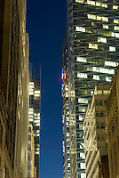 THIS IMAGE IS AVAILABLE EXCLUSIVELY FROM CORBIS.....Please search for image # 42-19896674 on www.corbis.com....Office Buildings on 40th Street Illuminated at Dusk, Midtown Manhattan, New York City, New York State, USA