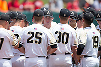 The Army Black Knights huddle up prior to the game against the North Carolina State Wolfpack at Doak Field at Dail Park on June 3, 2018 in Raleigh, North Carolina. The Wolfpack defeated the Black Knights 11-1. (Brian Westerholt/Four Seam Images)