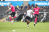1st May 2021; Liberty Stadium, Swansea, Glamorgan, Wales; English Football League Championship Football, Swansea City versus Derby County; George Edmundson of Derby County heads the ball to stop the drive from Jamal Lowe of Swansea City
