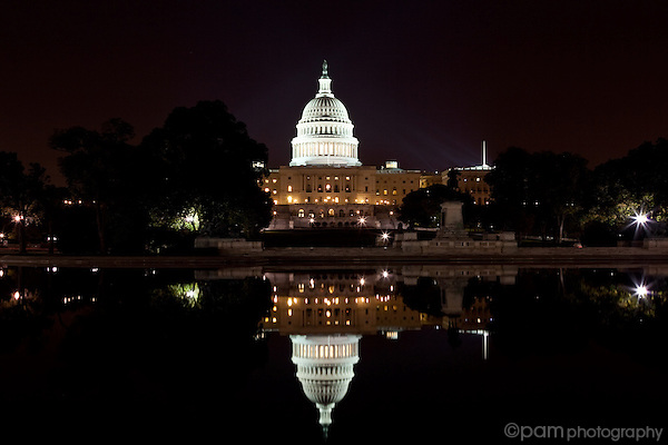 US Capitol and its reflection before sunrise