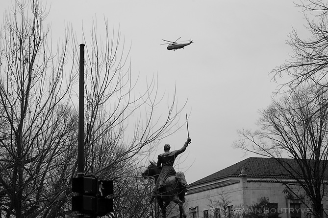 An US Marine helicopter carrying former President Barack Obama flies over a statue of Simon Bolivar as Obama leaves the ceremony on Inauguration Day in Washington, DC on Jan. 20, 2017.