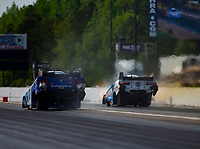 May 4, 2018; Commerce, GA, USA; NHRA funny car driver Tim Wilkerson (left) races alongside John Force during qualifying for the Southern Nationals at Atlanta Dragway. Mandatory Credit: Mark J. Rebilas-USA TODAY Sports