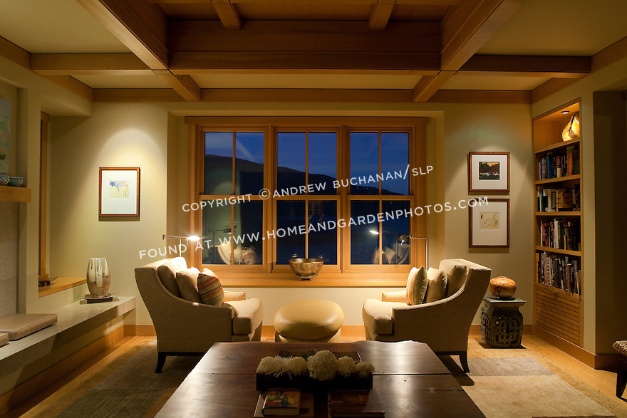 Natural wood trim, built-ins and box beam ceiling provide warm accents in this Pacific Northwest living room.