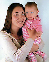 Pictured L-R: Jennifer Davies (known as Jenny) holding her son Andrew, her other son Jac, died in a house fire in the Alltwen area of Pontardawe, south Wales. Wednesday 27 July 2016<br /> Re: A four-year-old boy has died following a fire at a house in Neath Port Talbot.<br /> Fire crews were called to the property in Lon Tanyrallt, Alltwen, near Pontardawe, at 1.40am on Wednesday.<br /> They rescued the boy from an upstairs bedroom in the two-storey semi-detached house but he died at the scene.<br /> A three-year-old boy was also rescued and take to hospital along with his sister, six, and mother who had both managed to escape the blaze.<br /> They were all suffering from suspected smoke inhalation.<br /> Mid and West Wales Fire and Rescue Service said the woman, who is believed to be in her 20s, called for help and neighbours tried to get in to help the stranded children.