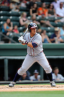 Catcher Bryan De La Rosa (26) of the Rome Braves bats in a game against the Greenville Drive on Sunday, June 14, 2015, at Fluor Field at the West End in Greenville, South Carolina. Rome won, 5-2. (Tom Priddy/Four Seam Images)