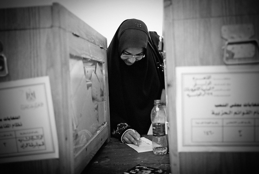 An Egyptian woman fills out her ballot paper on the second day of parliamentary elections at a voting station in Abbassia, Cairo, Egypt, Tuesday, Nov. 29, 2011. Tuesday marks the second and final day of the first round of parliamentary elections in Egypt since Hosni Mubarak's ouster, a giant step toward what many in the country hope will be a democratic Egypt after decades of dictatorship.