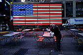 New York, New York<br /> March 18, 2020<br /> 10:36 AM<br /> <br /> Manhattan under coronavirus pandemic. <br /> <br /> Times Square void of tourists, but inhabited by the homeless.