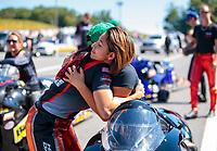 Sep 15, 2019; Mohnton, PA, USA; NHRA pro stock motorcycle rider Jianna Salinas hugs Angelle Sampey during the Reading Nationals at Maple Grove Raceway. Mandatory Credit: Mark J. Rebilas-USA TODAY Sports