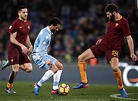 Calcio, Serie A: Roma, stadio Olimpico, 1marzo 2017.<br /> Lazio's Felipe Anderson (c) in action with Roma'a Kostas Manolas (l) and Federico Fazio (r) during the Italian TIM Cup 1st leg semifinal football match between Lazio and AS Roma at Rome's Olympic stadium, on March 1, 2017.<br /> UPDATE IMAGES PRESS/Isabella Bonotto