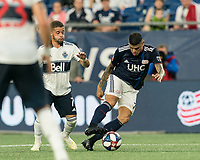 FOXBOROUGH, MA - JULY 17: Gustavo Bao #7 dribbles during a game between Vancouver Whitecaps and New England Revolution at Gillette Stadium on July 17, 2019 in Foxborough, Massachusetts.