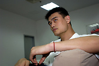 NBA Houston Rockets player Yao Ming rests at VIP room before attending a press conference for the 2007 Special Olympics in Beijing, China.  July 21, 2006. (photo by Lou Linwei/Sinopix)