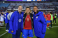 JACKSONVILLE, FL - NOVEMBER 10: Carli Loyd #10 and Imani Dorsey of the USA and Raquel Rodriguez #11 of Costa Rica share a moment together during a game between Costa Rica and USWNT at TIAA Bank Field on November 10, 2019 in Jacksonville, Florida.