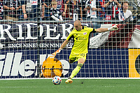 FOXBOROUGH, MA - JULY 25: Brad Knighton #18 of New England Revolution takes a goal kick during a game between CF Montreal and New England Revolution at Gillette Stadium on July 25, 2021 in Foxborough, Massachusetts.