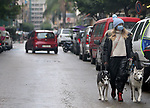 Lebanese wearing masks as a means of protection against the coronavirus walk, during the lockdown imposed by the authorities in a bid to slow the spread of the coronavirus, in Beirut, Lebanon, on January 29, 2021. Photo by Haitham Moussawi