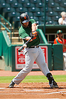 Joey Rapp (26) of the Augusta GreenJackets makes contact with the baseball against the Greensboro Grasshoppers at NewBridge Bank Park on August 11, 2013 in Greensboro, North Carolina.  The GreenJackets defeated the Grasshoppers 6-5 in game one of a double-header.  (Brian Westerholt/Four Seam Images)