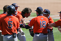 Auburn Tyler Miller (10) runs home for a score, Saturday, April 3, 2021 during the sixth inning of a baseball game at Baum-Walker Stadium in Fayetteville. Check out nwaonline.com/210404Daily/ for today's photo gallery. <br /> (NWA Democrat-Gazette/Charlie Kaijo)