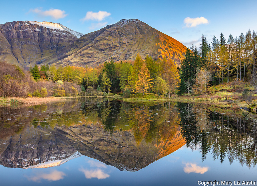 Glencoe, Scotland: A small pond with fall reflections and the mountains of Glen Coe at sumset