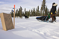 Kjetil Backen's team passes a *Welcome to the Yukon* sign on his way into the Ruby checkpoint on Friday during the 2008 Iditarod