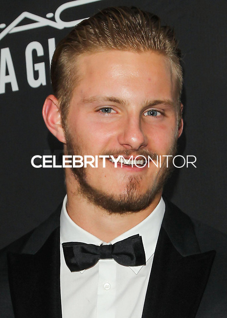 HOLLYWOOD, LOS ANGELES, CA, USA - OCTOBER 29: Alexander Ludwig arrives at the 2014 amfAR LA Inspiration Gala at Milk Studios on October 29, 2014 in Hollywood, Los Angeles, California, United States. (Photo by Celebrity Monitor)