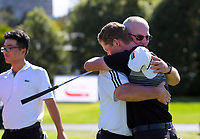 Daniel Hillier hugs his dad after winning the final against Jang Hyun Lee. Final day of the Jennian Homes Charles Tour / Brian Green Property Group New Zealand Super 6s at Manawatu Golf Club in Palmerston North, New Zealand on Sunday, 8 March 2020. Photo: Dave Lintott / lintottphoto.co.nz