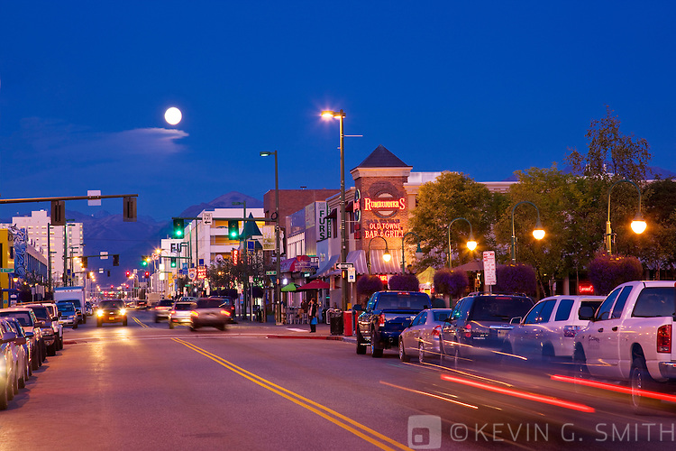 Full moon rise over downtown Anchorages 4th avenue, Twilight, late summer, Anchorage, Southcentral Alaska, USA.