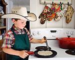 Ethan cooking a tortilla.