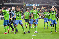 LOS ANGELES, CA - OCTOBER 29: Kelvin Leerdam #18, Roman Torres #29 and Raul Ruidiaz #9 celebrate their MLS Western Conference victory over Los Angeles FC during a game between Seattle Sounders FC and Los Angeles FC at Banc of California Stadium on October 29, 2019 in Los Angeles, California.