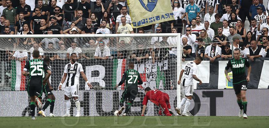 Calcio, Serie A: Juventus - Sassuolo, Turin, Allianz Stadium, September 16, 2018.<br /> Sassuolo's Khoumael Babacar (second from left) scores during theItalian Serie A football match between Juventus and  Sassuolo at Torino's Allianz stadium, September 16, 2018.<br /> UPDATE IMAGES PRESS/Isabella Bonotto