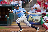 Jorge Bonifacio (16) of the Northwest Arkansas Naturals follows through his swing after making contact on a pitch during a game against the Springfield Cardinals at Hammons Field on August 23, 2013 in Springfield, Missouri. (David Welker/Four Seam Images)