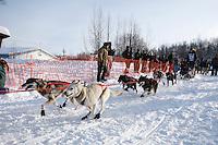 Sunday February 27, 2010   Tobin Sworts leaves the start line of the Junior Iditarod at Willow Lake , Alaska