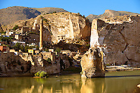 Remains of medieval Artukid Old Tigris Bridge – Built in 1116 by Artukid Fahrettin Karaaslan, the biggest in Anatolia at the time, with the old town Hasankeyf and its ruins on the cliffs abover the river Tigris. The minaret is of the El Rizk Mosque built 1409.  Turkey. 8