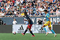 FOXBOROUGH, MA - AUGUST 8: Maciel #13 of New England Revolution passes the ball as Quinn Sullivan #33 of Philadelphia Union closes during a game between Philadelphia Union and New England Revolution at Gillette Stadium on August 8, 2021 in Foxborough, Massachusetts.
