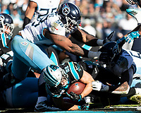 CHARLOTTE, NC - NOVEMBER 3: Christian McCaffrey #22 of the Carolina Panthers runs for a touchdown during a game between Tennessee Titans and Carolina Panthers at Bank of America Stadium on November 3, 2019 in Charlotte, North Carolina.