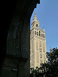 Cathedral of Saint Mary of the See and La Giralda in Seville is the largest gothic cathedral in the world. It occupies the site of Hagia Sophia, a mosque built by the Almohads in the late 12th century. La Giralda, its bell tower, is a legacy from the Moorish structure.