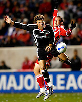 DC United defender Greg Vanney (6) and Chicago Fire forward Chad Barrett (9) collide while going for the ball.  The Chicago Fire defeated D. C. United 1-0 during the first leg of the MLS Eastern Conference Semifinal Series at Toyota Park in Bridgeview, IL, on October 25, 2007.
