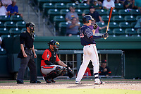 Center fielder Tyler Esplin (25) of the Greenville Drive in a game against the Aberdeen IronBirds on Sunday, July 11, 2021, at Fluor Field at the West End in Greenville, South Carolina. The catcher is Christopher Burgess (24) and the umpire is Jose Lozada. (Tom Priddy/Four Seam Images)