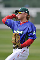 Trent Kemp (17) of the Greenville Drive warms up before a game against the Asheville Tourists on Sunday, April 10, 2016, at Fluor Field at the West End in Greenville, South Carolina. Greenville won 7-4. (Tom Priddy/Four Seam Images)