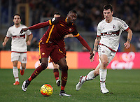 Calcio, Serie A: Roma vs Milan. Roma, stadio Olimpico, 9 gennaio 2016.<br /> Roma's Umar Sadiq, left, is challenged by AC Milan's Alessio Romagnoli during the Italian Serie A football match between Roma and Milan at Rome's Olympic stadium, 9 January 2016.<br /> UPDATE IMAGES PRESS/Isabella Bonotto