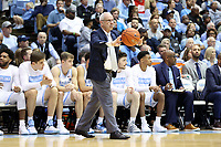 CHAPEL HILL, NC - MARCH 03: Head coach Roy Williams of the University of North Carolina passes the ball during a game between Wake Forest and North Carolina at Dean E. Smith Center on March 03, 2020 in Chapel Hill, North Carolina.