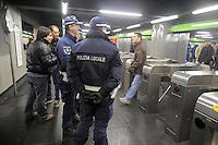 - Milan subway station Famagosta, policemen in the security service....- Milano, stazione Famagosta della Metropolitana, vigili urbani in servizio di sicurezza