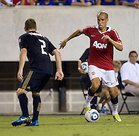 Gabriel Obertan (26) of Manchester United tries to get past Jordan Harvey (2) of Philadelphia Union during a friendly match at Lincoln Financial Field in Philadelphia, Pennsylvania.  Manchester United defeated Philadelphia Union, 1-0.