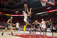 COLLEGE PARK, MD - DECEMBER 28: Hailey Brown #15 of Michigan defends a shot by Kaila Charles #5 of Maryland. during a game between University of Michigan and University of Maryland at Xfinity Center on December 28, 2019 in College Park, Maryland.