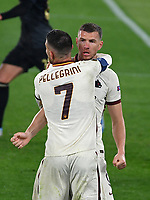 Football: Europa League - quarter finals 2nd leg AS Roma vs Ajax, Olympic Stadium. Rome, Italy, March 15, 2021.<br /> Roma's Edin Dzeko (in front of) celebrates after scoring with his teammate Lorenzo Pellegrini (behind) during the Europa League football match between Roma at Rome's Olympic stadium, Rome, on April 15, 2021.  <br /> UPDATE IMAGES PRESS/Isabella Bonotto