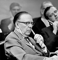1967 FILE -<br /> <br /> Alberta's Premier E. C. Manning, left, pays strict attention as Quebec's Premier Johnson at the Confederation of Tomorrow conference accuses certain unnamed premiers of trying to create the impression that it had been designed to meet Quebec's complaints with an aspirin. Manning, on the other side of the debate at the meeting, obviously was one of the men referred to.<br /> <br /> PHOTO :  Norman JAMES - Toronto Star Archives - AQP