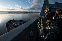 130501-N-DR144-564 COOK INLET, Alaska (May 1, 2013)- Sailors watch from the port bridge wing as San Antonio-class amphibious transport dock ship USS Anchorage (LPD 23) approaches the city of Anchorage, Alaska. Anchorage arrived at its namesake city of Anchorage, Alaska for its commissioning ceremony scheduled to take place May 4. (U.S. Navy photo by Mass Communication Specialist 1st Class James R. Evans / RELEASED)