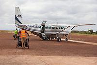 Tanzania.  Lake Manyara Airport.  Loading Luggage on Auric Air Cessna Aircraft.