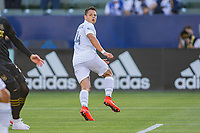 CARSON, CA - MAY 8: Javier Hernandez #14 of the Los Angeles Galaxy takes a shot and scores and celebrates during a game between Los Angeles FC and Los Angeles Galaxy at Dignity Health Sports Park on May 8, 2021 in Carson, California.