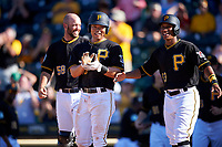 Pittsburgh Pirates Jacob Stallings (58), Connor Joe (center), and Chris Bostick (63) wait to congratulate Edwin Espinal (not pictured) on hitting a game-winning three-run home run during a Spring Training game against the Tampa Bay Rays on March 10, 2017 at LECOM Park in Bradenton, Florida.  Pittsburgh defeated New York 4-1.  (Mike Janes/Four Seam Images)